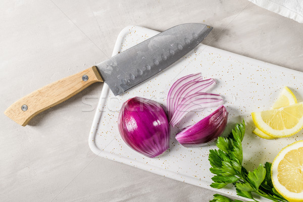 Sliced red onion, lemon and parsley leaves Stock photo © homydesign