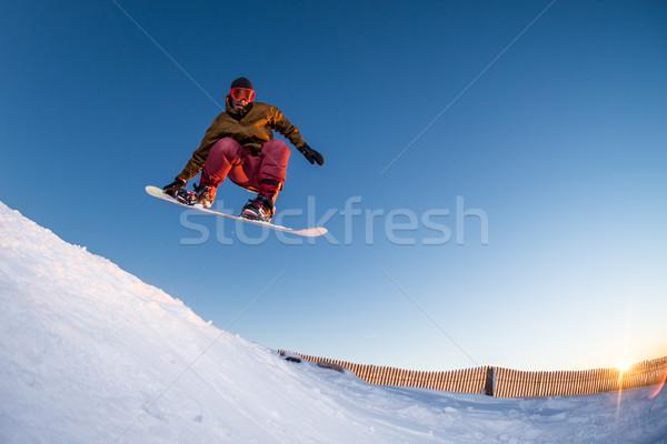 Snowboarden bergen jonge man man sport zonsondergang Stockfoto © homydesign