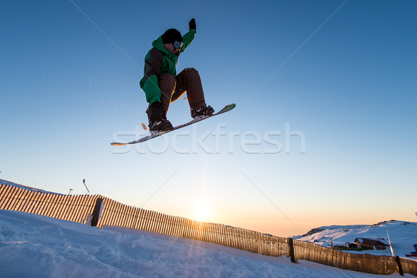 Snowboarder at jump Stock photo © homydesign