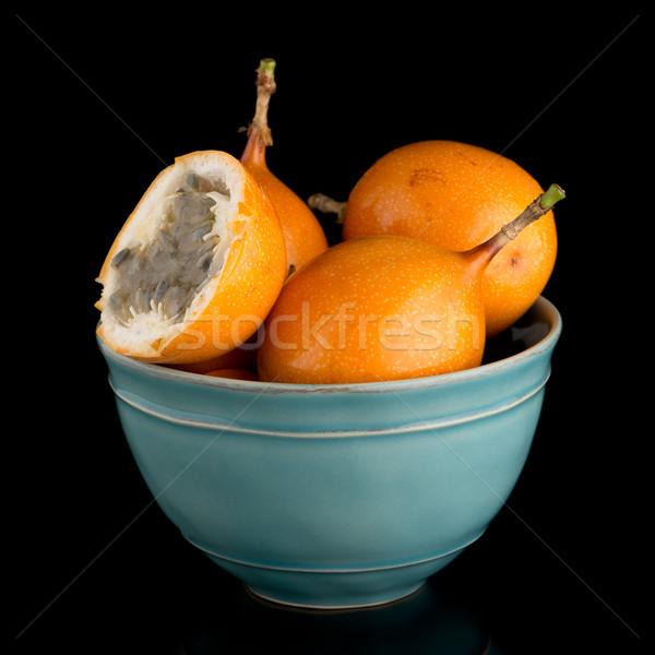 Pasión frutas cerámica azul tazón negro Foto stock © homydesign