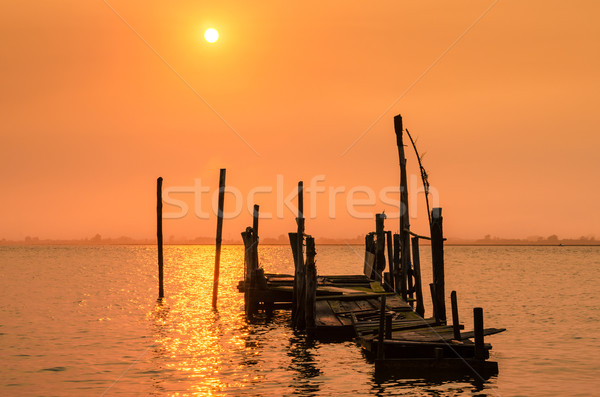 Stock photo: Old dock sunset