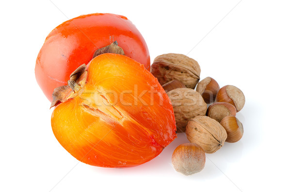 Ripe persimmons and nuts Stock photo © homydesign