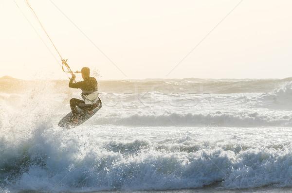 Saltar hermosa aerosol puesta de sol paisaje cuerpo Foto stock © homydesign