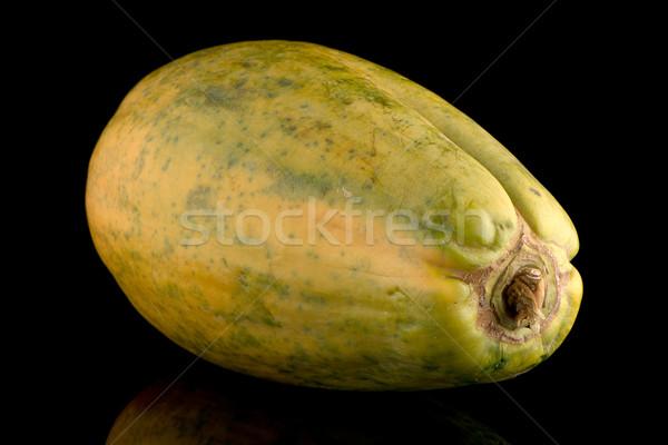 Papaya fruit on black background Stock photo © homydesign