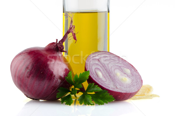 Red onions and olive oil Stock photo © homydesign