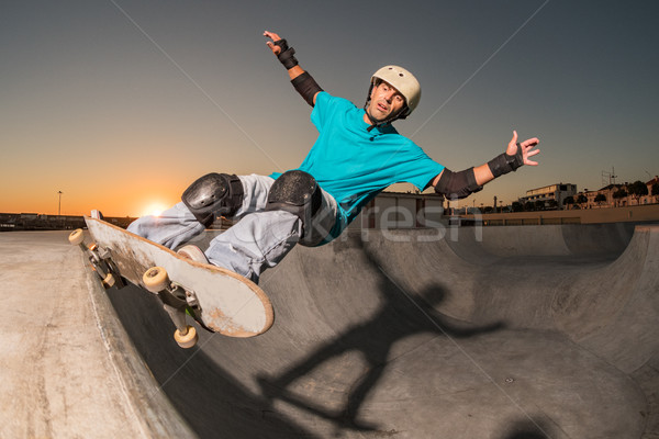 Skateboarder in a concrete pool  Stock photo © homydesign