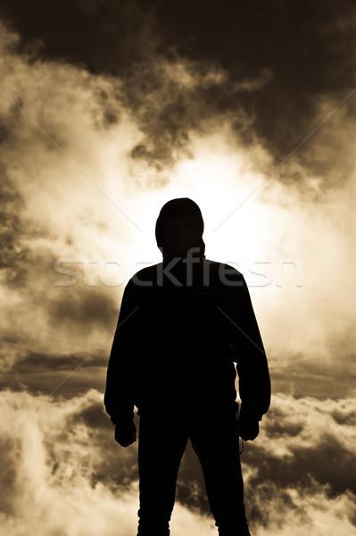 Silhueta homem persistente nuvens luz Foto stock © hraska