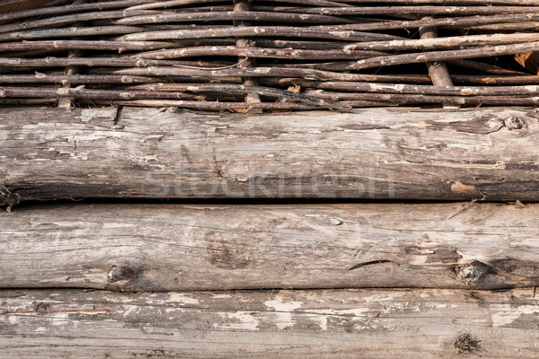 Wooden logs and wattle wall Stock photo © hraska