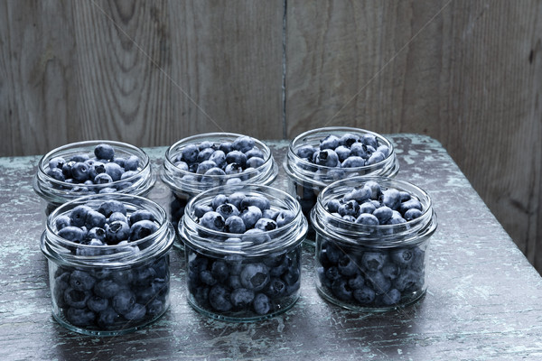 Jar bleuets fruits table en bois alimentaire Photo stock © hraska