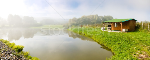 Stock photo: Fishing lodge above the pond
