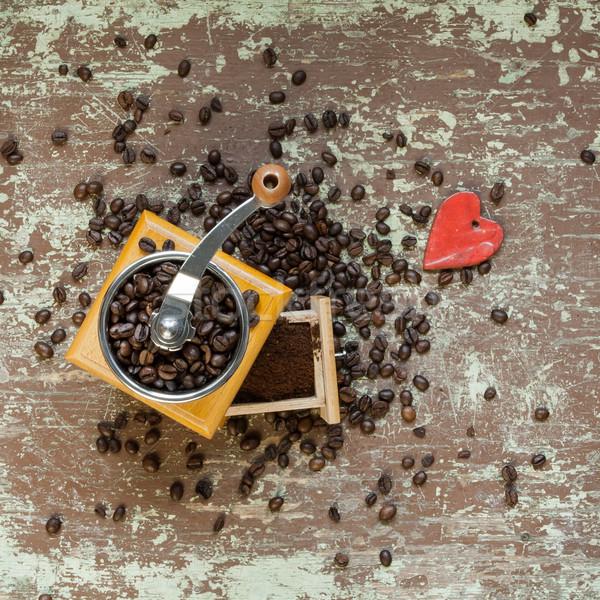Coffee grinder on wooden board Stock photo © hraska