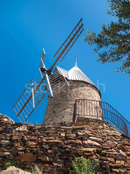 Blue sky behind a windmill Stock photo © hraska
