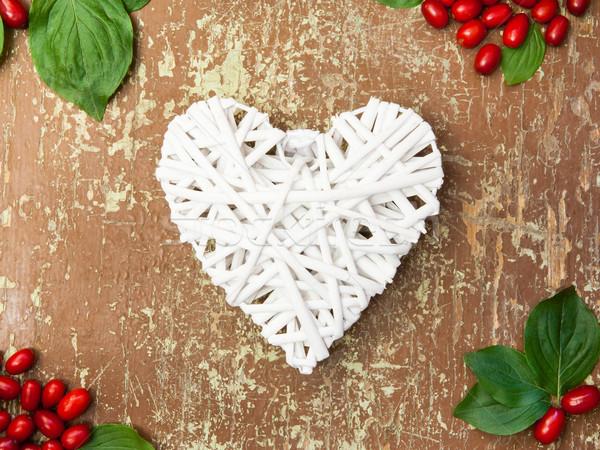 Red berries and white heart shape Stock photo © hraska