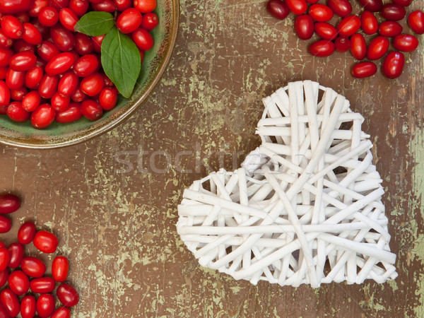 Berries and white colored heart shape Stock photo © hraska
