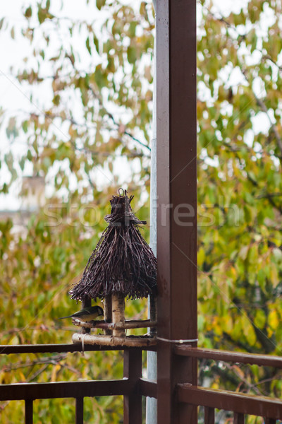 Wooden bird feeder on the house terrace Stock photo © hraska
