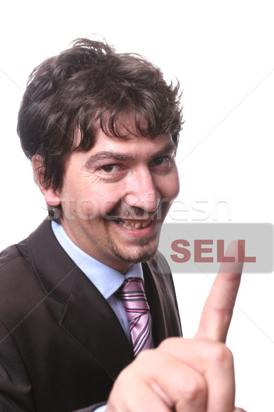 young business man presses the sell button Stock photo © hsfelix