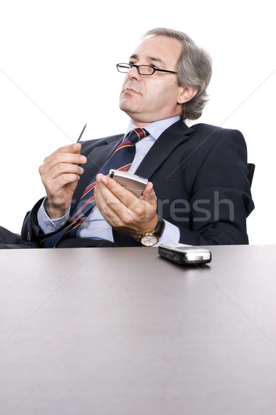 Mature Businessman working with PDA Stock photo © hsfelix