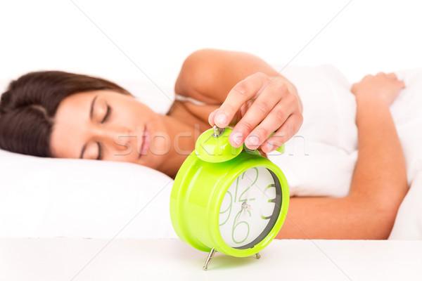 Nő ágy felfelé hang ébresztőóra óra Stock fotó © hsfelix