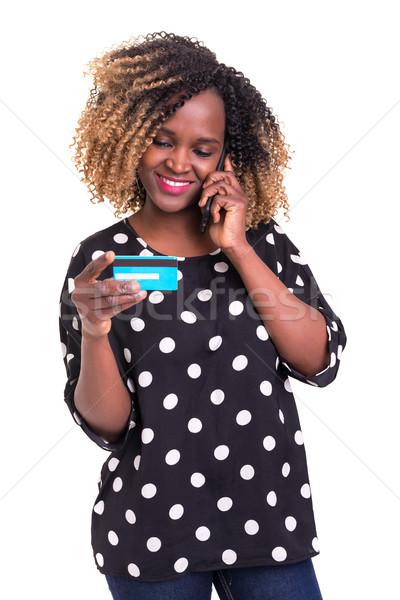 女性の携帯電話 クレジットカード 美しい アフリカ 孤立した 白 ストックフォト © hsfelix