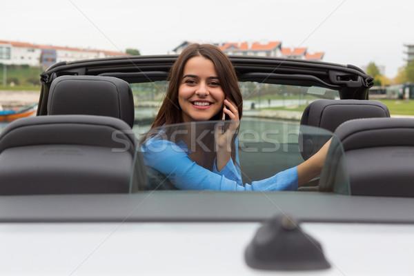 Donna d'affari telefono sorriso felice viaggio mobile Foto d'archivio © hsfelix
