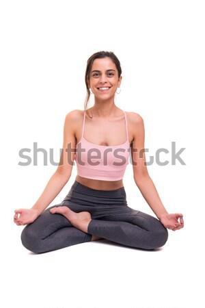 Jóga sportos fiatal nő gyakorlat izolált fehér Stock fotó © hsfelix