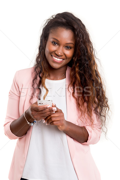 Sms fiatal afrikai nő küldés okostelefon Stock fotó © hsfelix