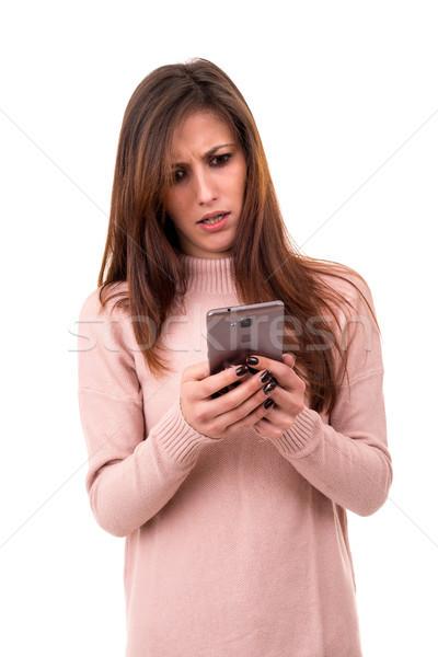Nő telefonál fiatal gyönyörű nő telefon izolált fehér Stock fotó © hsfelix