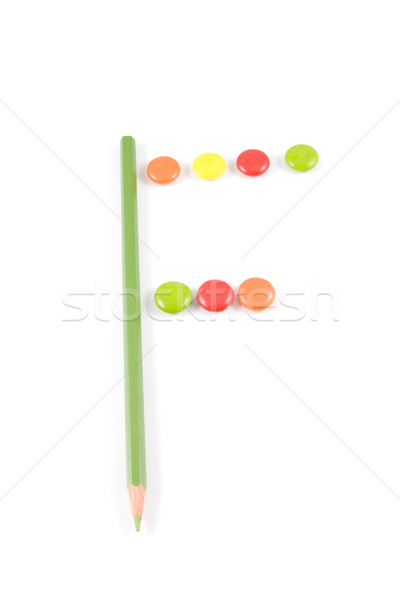 Letter F made of colored chocolates Stock photo © hsfelix