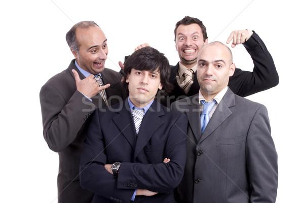 üzleti csapat pózol hátsó férfiak viccelődés izolált Stock fotó © hsfelix