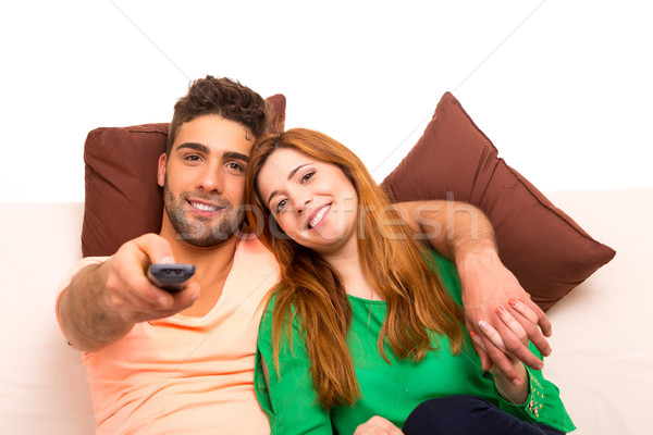 Paar kijken iets televisie bank Stockfoto © hsfelix
