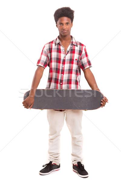 фигурист мальчика молодые черный позируют студию Сток-фото © hsfelix