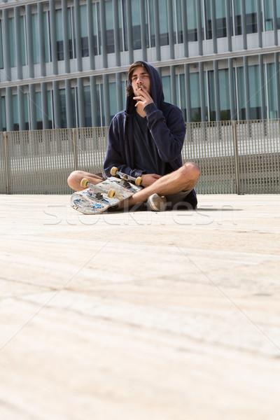 Gördeszkás fiatal srác helyi égbolt férfi sport Stock fotó © hsfelix