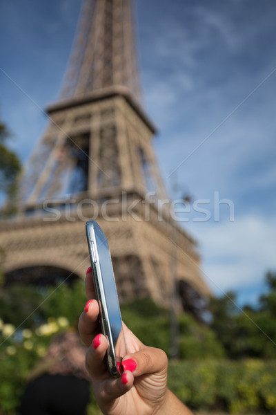Woman consulting her smartphone  Stock photo © hsfelix
