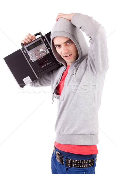 Young man listening to music Stock photo © hsfelix