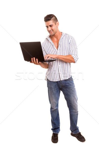 Adam çalışma dizüstü bilgisayar genç yakışıklı adam dizüstü bilgisayar Stok fotoğraf © hsfelix