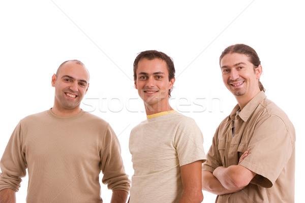Csoport barátok pózol izolált fehér mosoly Stock fotó © hsfelix
