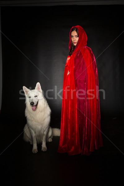 Rosso nascondere donna indossare posa studio Foto d'archivio © hsfelix