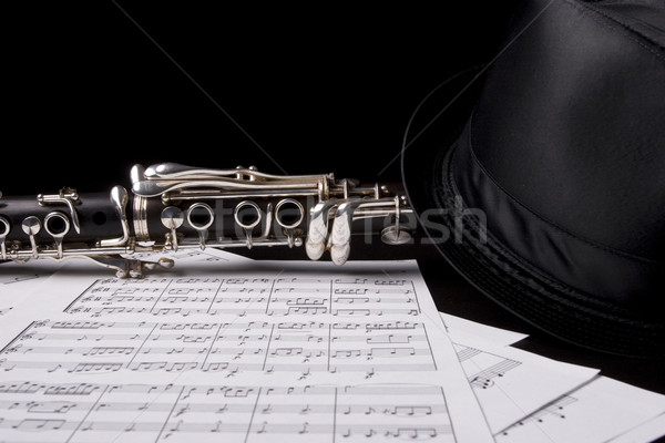 Clarinet isolated over sheet music Stock photo © hsfelix