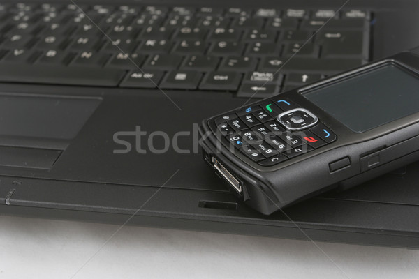 携帯電話 孤立した ノートパソコンのキーボード フォーカス ビジネス オフィス ストックフォト © hsfelix
