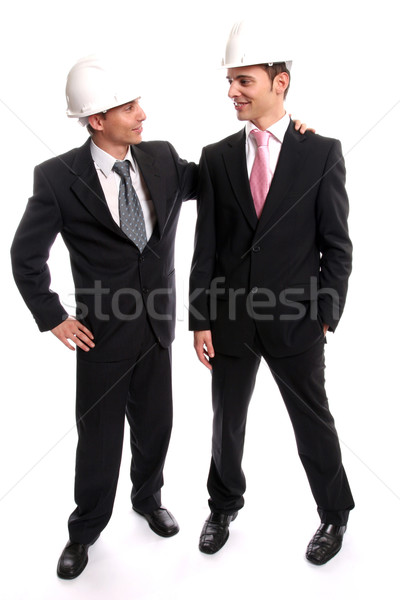 Two young Engineers completing a deal Stock photo © hsfelix