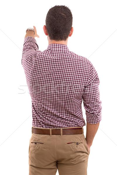 Wow wygląd młody człowiek powrót wskazując Zdjęcia stock © hsfelix