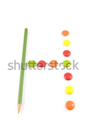 Letter H made of colored chocolates Stock photo © hsfelix