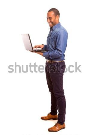 African om de afaceri tineri lucru laptop calculator Imagine de stoc © hsfelix