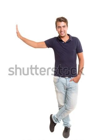 Produktu prezentacji młody człowiek odizolowany biały Zdjęcia stock © hsfelix