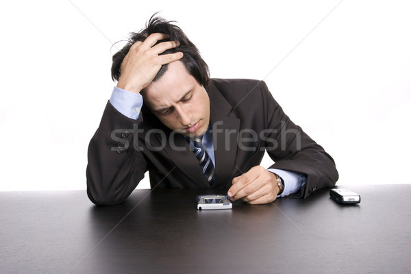 young worried businessman, working with pda Stock photo © hsfelix