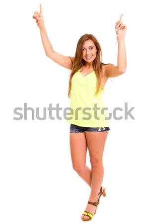 Tiener mooie wijzend iets geïsoleerd witte Stockfoto © hsfelix