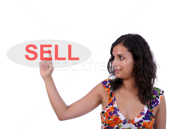Young beautiful woman pressing the sell key Stock photo © hsfelix
