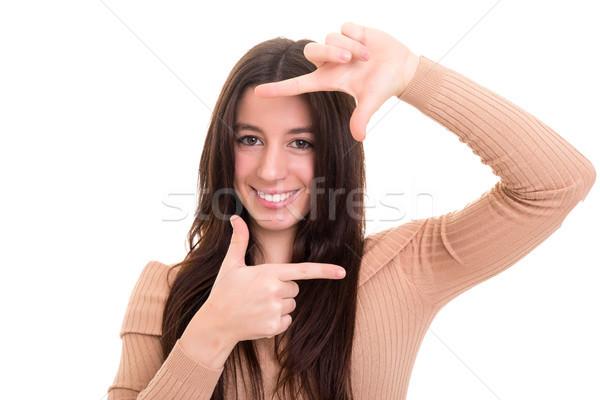 Cadre moi jeune femme clé geste Photo stock © hsfelix