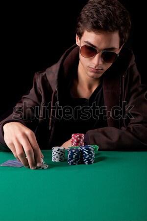 Woman playing poker Stock photo © hsfelix