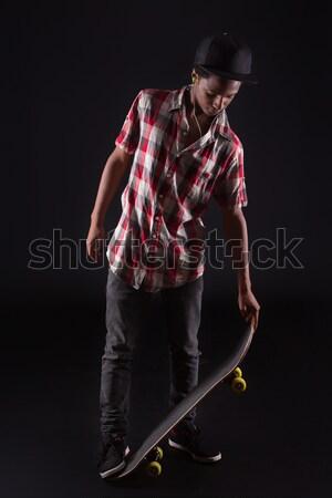 Patenci erkek genç siyah poz stüdyo Stok fotoğraf © hsfelix